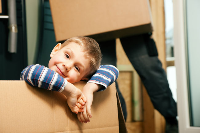 photo of young boy, the child of a separating couple in Edmonton, moved into a new home with one of his parents, enjoying his new bedroom