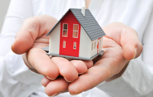 image or a home in the owners hands, symbolizing a property that was owned separately and is exempt from the division of property in a divorce