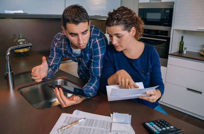 Edmonton couple with bad credit are looking at their finances and determining their ability to purchase a new home in the Edmonton area