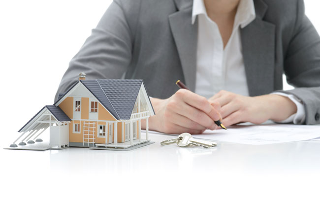 Self employed business owner completing mortgage application to purchase a new home in Alberta